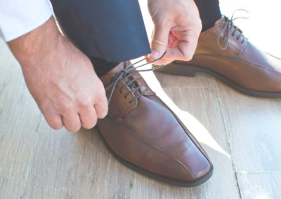 Gentleman preparing his shoes